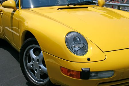 A view of a bright yellow sports car from an angle Stock Photo - 1150731