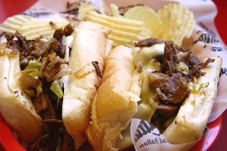 steak sandwich: A closeup of a philly cheese steak sandwich