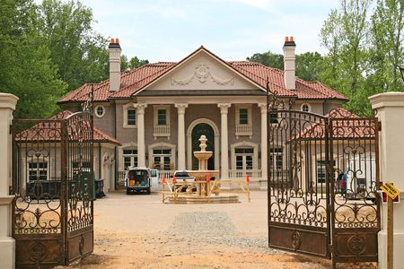 gated: A large gated mansion under new construction Stock Photo