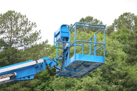 A bright blue lifting platform for construction work Imagens