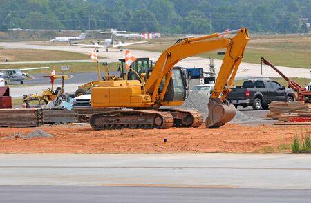 equipment: Heavy construction equipment working on an airport runway