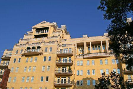 New nice stucco condominiums rising into a blue sky Stock Photo - 1349462