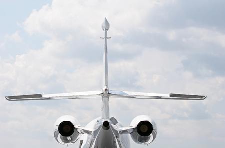 Rear view of a private jet with wings and jets showing