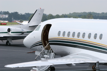 Modern private jets waiting departure at an airport
