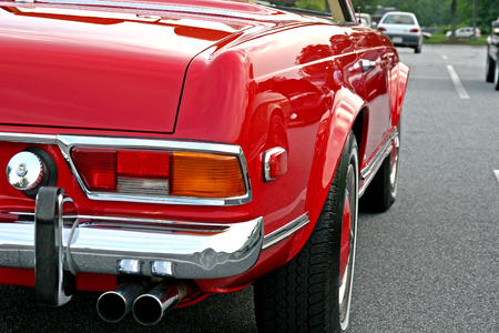 The rear and side of a classic red convertible Stock Photo - 1424909