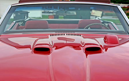 Hood scoops on a red classic muscle car