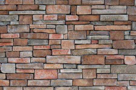 wall textures: A colorful stone wall useful for backgrounds Stock Photo