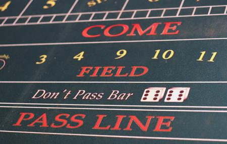craps: A Closeup of a craps table showing the pass line
