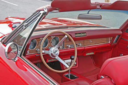 A classic red convertible with custom leather interior