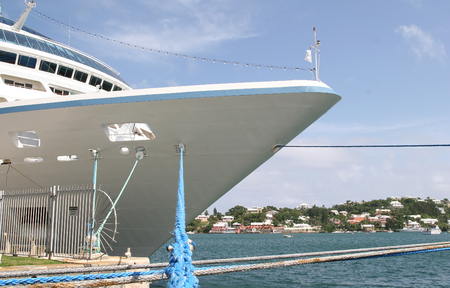 The bow of a luxury cruise ship tied to a dock Stok Fotoğraf