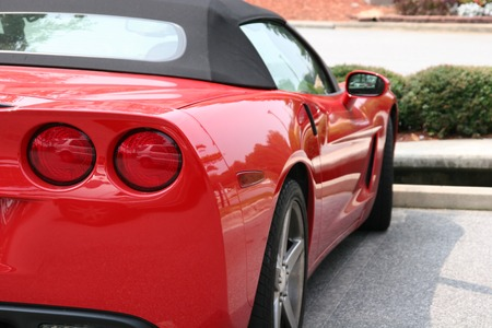 A bright red classic sports car from the rear Stock Photo - 1557999