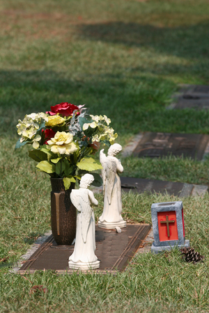 Some Flowers and monuments beside a grave