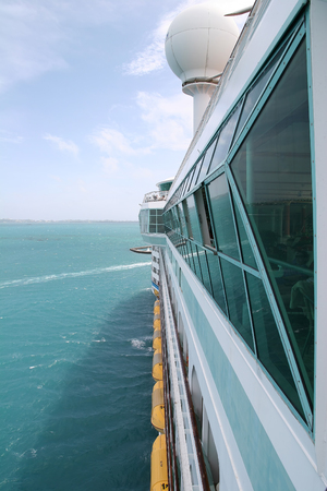 View down the side of a moving cruise ship photo
