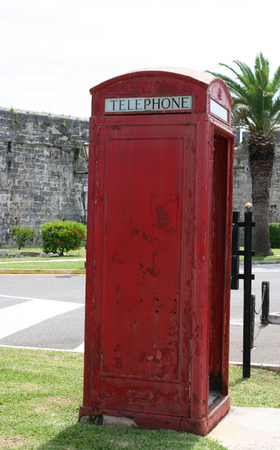 antique booth: An old fashioned red telephone booth in a public  park