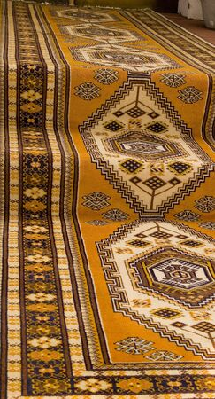 oriental rug: An oriental carpet runner on walkway and steps Stock Photo