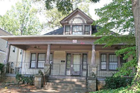 An old frame house on an urban street
