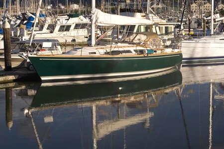green boat: A nice green boat tied up at a marina Stock Photo
