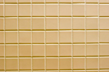 sidelit: A background of sidelit brown ceramic tile Stock Photo