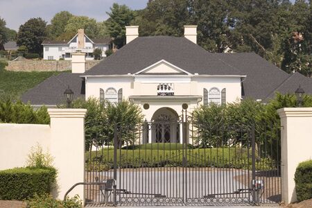 A nice pink stucco house behind an iron gate Stock Photo - 1989823