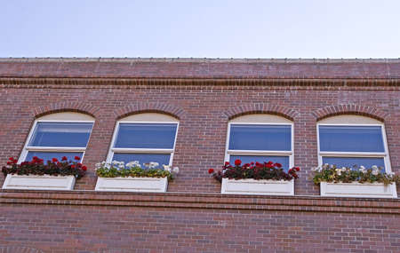 An old brick building with flower boxes in the wiindows