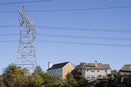 volts: High power electrical tower and lines over expensive houses