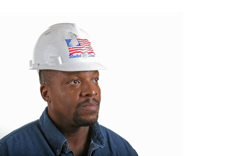Construction worker in hard hat with American flag looking into copy space