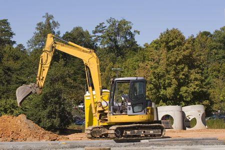 front end: A front end loader shoveling dirt into a dump truck
