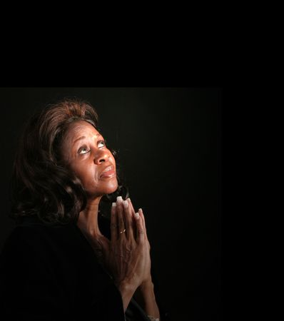 black gods: A spiritual  woman looking to heaven and praying Stock Photo