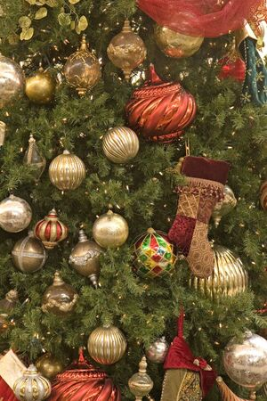 Silver Green and Red ornaments hanging on a christmas tree Stock Photo - 2167621