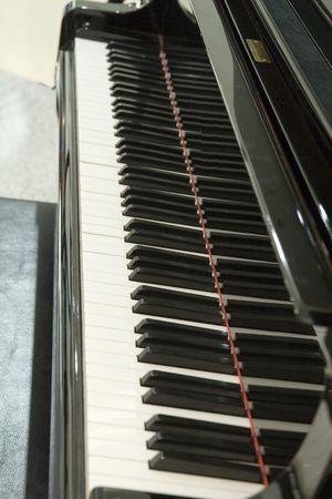 Close-up van een toetsenbord op een vleugel Stockfoto