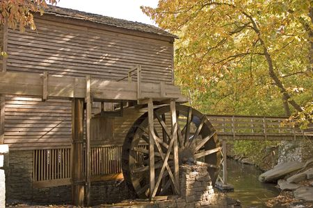 An old grist mill showing the water turning wheel photo