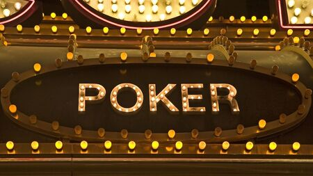 An old fashioned sign of light bulbs for a poker game