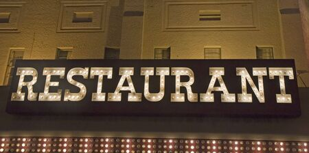 An old fashioned restaurant sign made of light bulbs