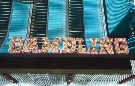 An old fashioned light bulb sign Gambling Imagens