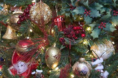 A custom christmas tree decorated with gold and red ornaments Stock Photo - 2197274