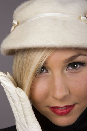 A fresh young fashion model posing with white hat and gloves Stock Photo - 2205987