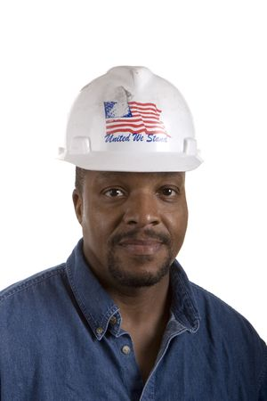 A black construction worker in denim shirt with hard hat isolated on white Фото со стока