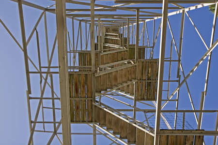 A fire tower from below looking up endless steps
