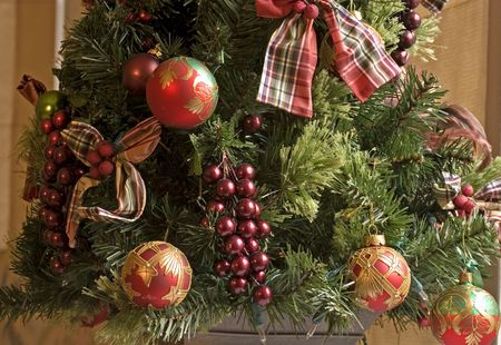 A custom christmas tree decorated with ribbons and berries Stock Photo - 2255699