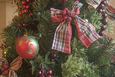 A nice Christmas tree decorated with ribbons and bows Stock Photo - 2264352