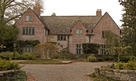 An old brick mansion and driveway on an estate photo