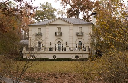 A large old stucco mansion in a winter lawn Stock Photo - 2347094