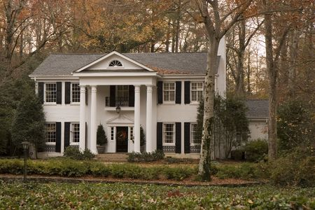 A nice old white house with columns in the fall Stock Photo - 2347095