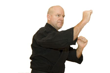 stance: A black belt martial artist in a fighting stance