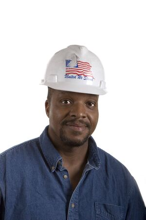 A black construction worker in denim shirt and hard hat on a white background