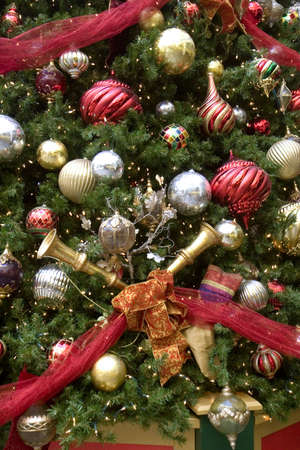 A christmas tree decorated with horns and balls and ribbons Stock Photo - 2414604