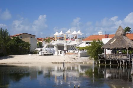sidewalk sale: Stage and shops by the beach in a lagoon Stock Photo