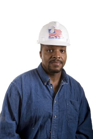 hard: A construction foreman in denim shirt and white hard hat isolated on white