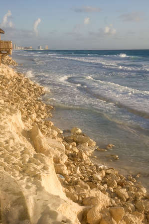 encroach: A section of beach in Mexico showing bad erosion and missing sand