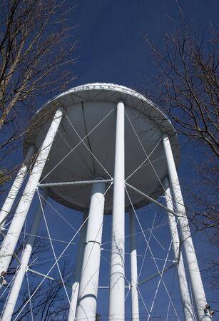 municipal utilities: A blue municipal water tower rising into the sky Stock Photo